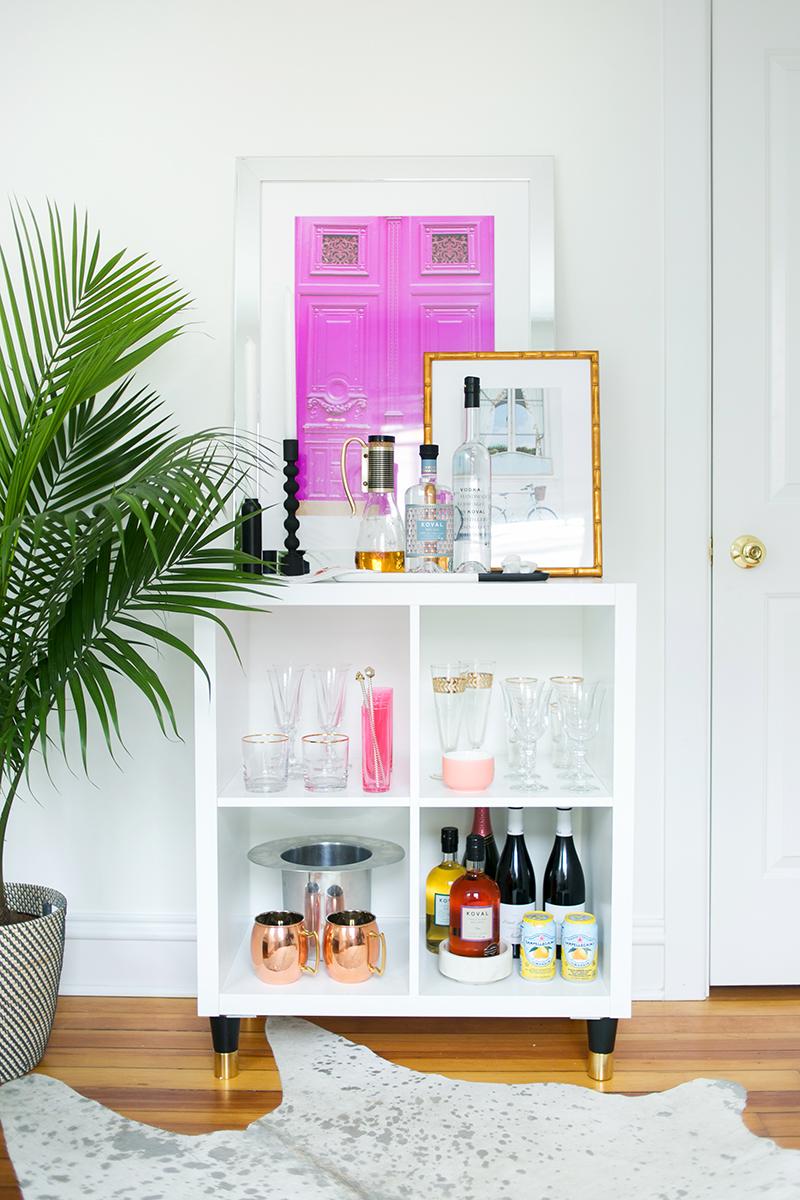 Adding feet to an Ikea Kallax shelf can transform it into a bar - The Every Girl. #kallax #kallaxhack #ikeahacks #barcart