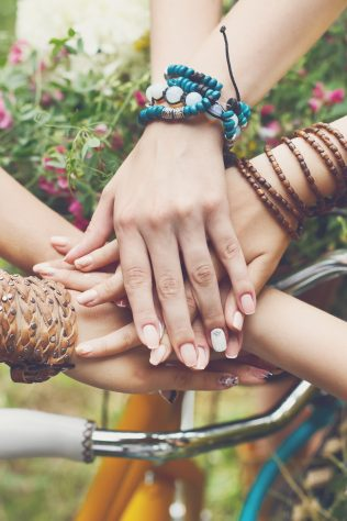 Women's hands joined together